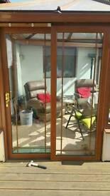 Pvc oak patio sliding door complete with glass