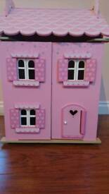 Wooden doll house and family