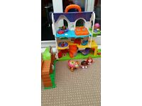 vtech house with three people and walking horse