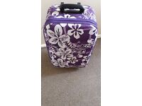 Purple flower suitcase