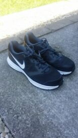 Black nike running shoes size 8.
