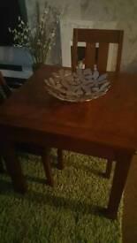 Next solid dark wood extendable table with 4 chairs