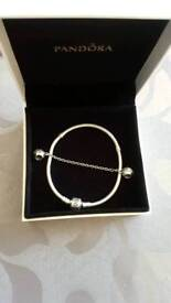 Genuine Pandora bracelet and heart safety chain.