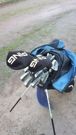 Ping golf clubs, bag and balls.