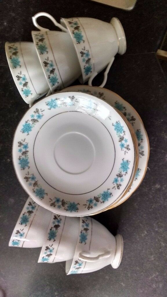 China tea set with 6 cups & saucers and side plates