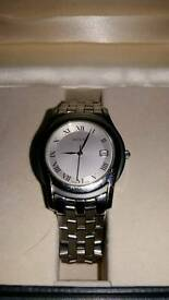 Genuine Gucci Swiss made watch boxed.