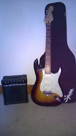Electric Squier guitar and amp