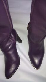 """Purple leather knee length boots. Gold toe trim detail and buckkes. Round toe and 3.75"""" heels"""