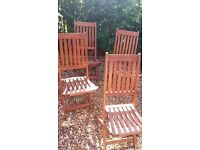 Four wooden folding garden chairs