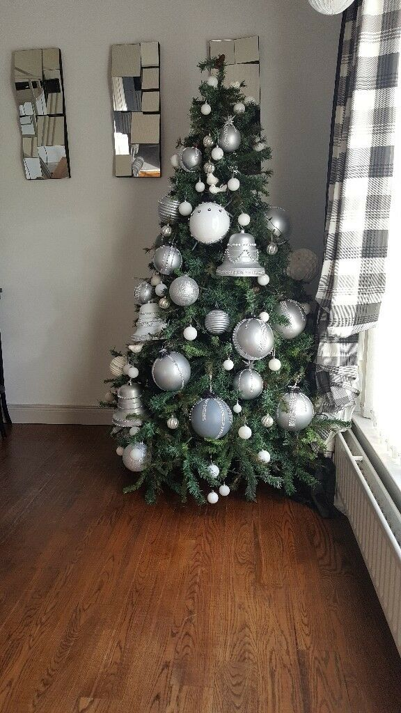 8ft christmas tree fully decorated with lights and fireplace garland