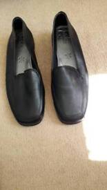 Lady's black flats size 5. Leather uppers - never worn