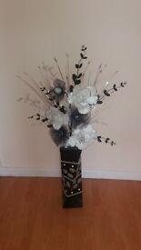 Flower arangement in tall vase