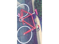 Very good bike. Good condition. Pink bike.had for 4 weeks only problem is front break don't work.