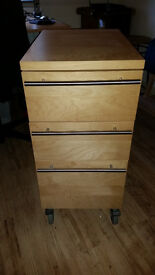 3-Drawer Cabinet on substantial castors. Very good condition. Ash tone in colour.