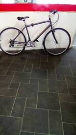 "Grey Raleigh Pioneer Hybrid Bike, 700c Wheels, 18 Speed, 19"" Frame"