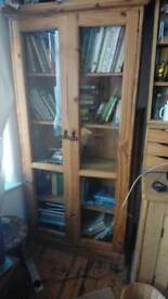 Wooden shelving unit with glass doors