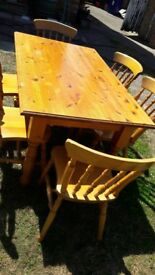 Pine table and chairs for sale.