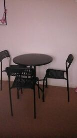 Table with three chairs for sale