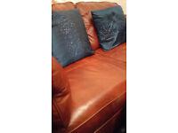 A tan two seater sofa
