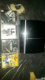 PS3 FOR SALE WITH 4 GAMES.