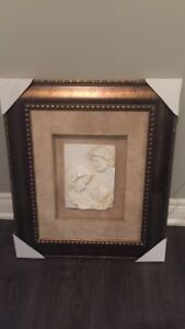 """Joseph, Mary and Jesus ivory cast in frame 23"""" W by 27.5"""" H"""