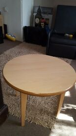Solid round wood table