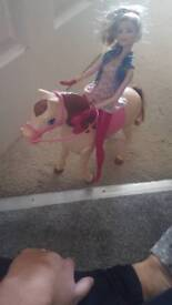 Barbie doll and walking horse