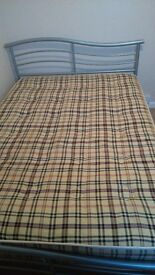 metal framed double bed and matress