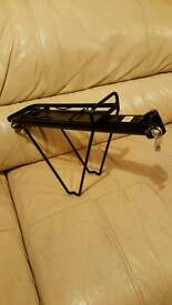 A black bike rack and bag in excellent condition never used