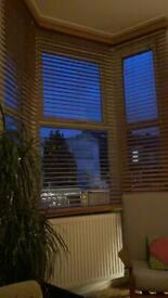 Wooden Venetian blinds for bay window