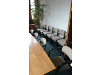 Light Brown Stackable Chairs on Brown Metal Frame