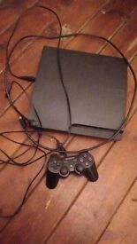 PS3 console with controller and HDMI cable.
