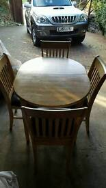 Pine extending table with 4 brown faux leather chairs