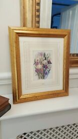gold framed picture of flowers