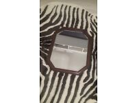 Mirror in a brown wooden frame
