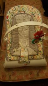 Baby bouncy chair excellent condition with vibration and music hardly use for newborns to 18kg
