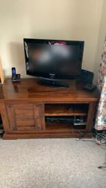 Dark wood television cabinet