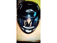 Nitro black bike/ motorbike helmet. Built in sunglasses and lift up jaw piece.