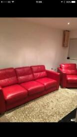 Red leather 3 seater settee , arm chair and footstool
