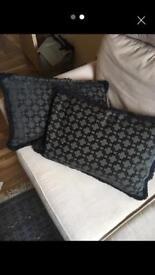 2 black cushions