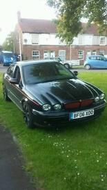 jaguar x type sport.2006. 2.2 black. red leather. sat nav.