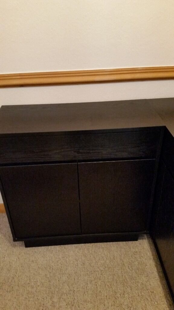 Black sideboards x 2in Haverhill, SuffolkGumtree - 2 x black sideboards/cupboards. Both in excellent condition, almost new. Measurements 80 cm wide, 35 cm depth and 80 cm height.. Very spacious and would look equally good as dining sideboards, lounge cupboards or TV stand with storage for boxes etc.,...