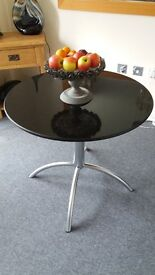 Lovely black and steel granite bistro table