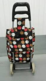 Shopping carry bag with wheels