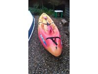 Malibu Two Ocean Kayak. Well used sit on top sea kayak with paddles
