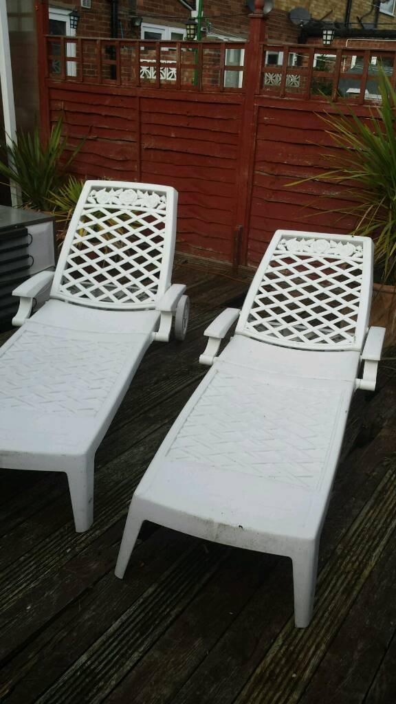 X 2 pool side plastic fold up large chunky decrative sun loungers..on wheels..