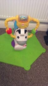 Fisher Price spinning zebra. This is in excellent condition