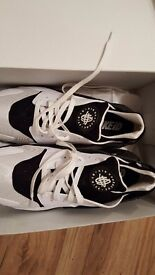 Brand new size 12 adult nike haurache trainers. Originally hadnsone name on them but i peeled it off