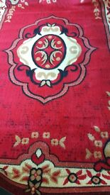 Cheap price good size Brand new rug in red and creamy colour size 270×180