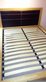 KING SIZE BED SOLID OAK WITH TWO UNDER BED DRAWS. CAN BE TAKEN APART TO TRANSPORT NO MATTRESS.